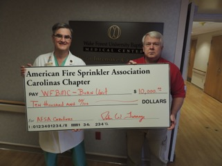 Carolinas Chapter members sponsor and participate in a charity golf tournament benefitting Wake Forest Baptist Health's Burn Center.